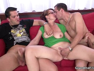 Busty mom enjoys sucking and riding two cocks