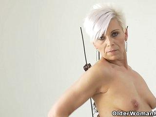 Euro milf Kathy teases us with a slow striptease
