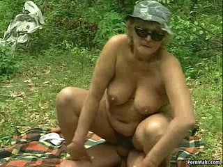 German BBW granny takes young cock outdoor