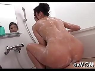 Sexy oriental mom strip tease